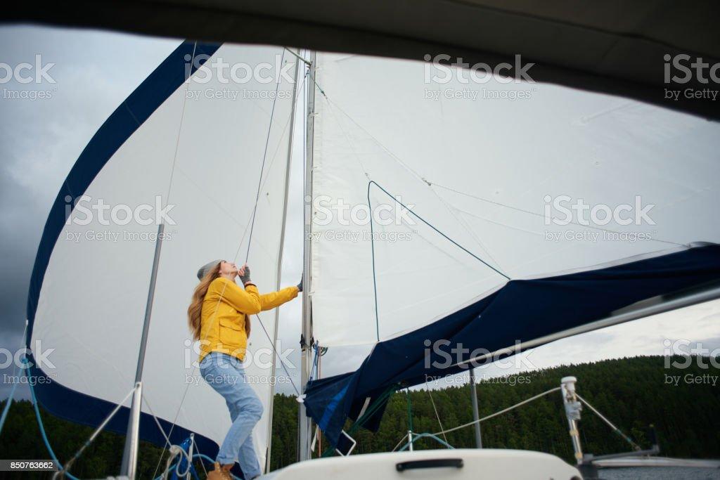 Woman sailing the boat stock photo