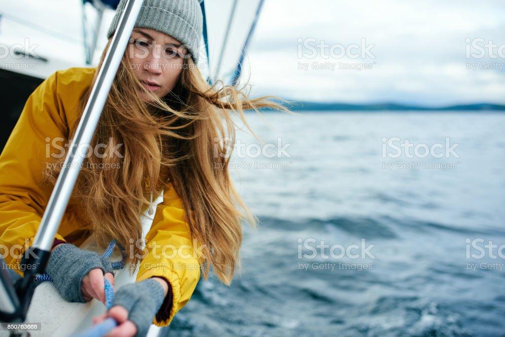 Woman sailing the yacht stock photo