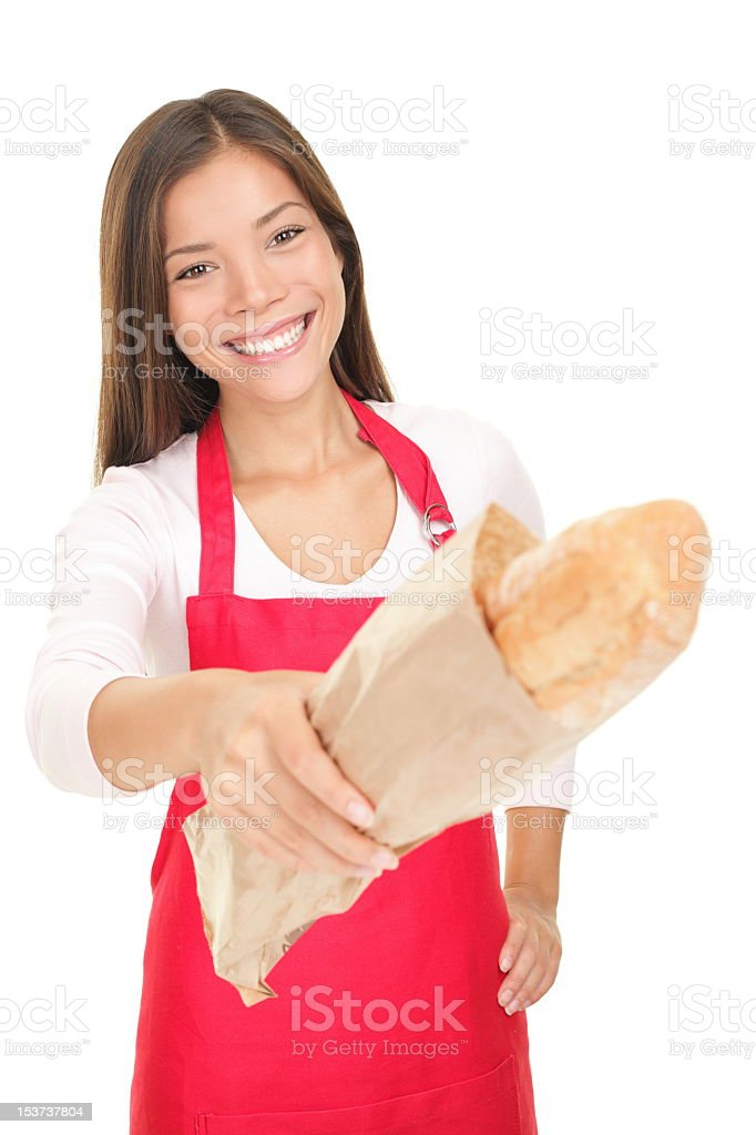 Woman sales clerk giving bread royalty-free stock photo