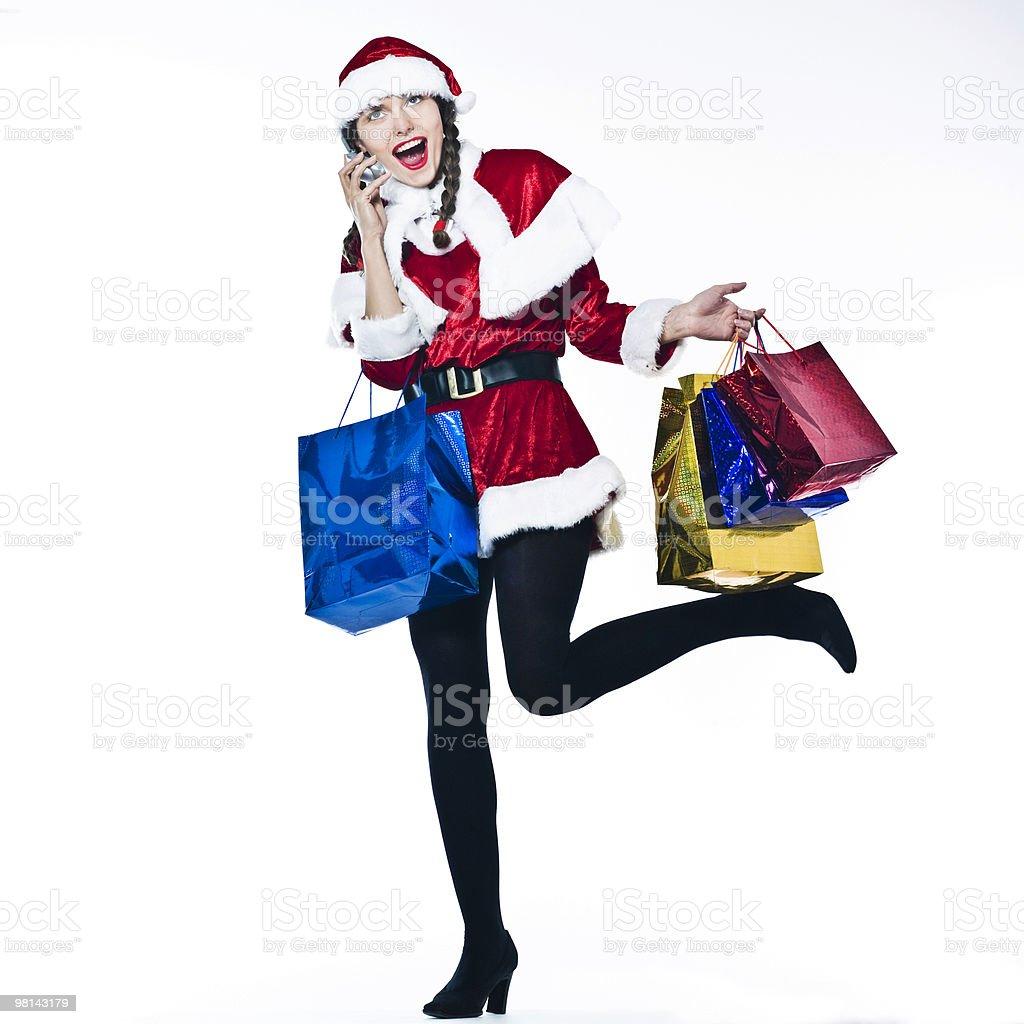 woman santa claus Christmas Shopping on the phone royalty-free stock photo