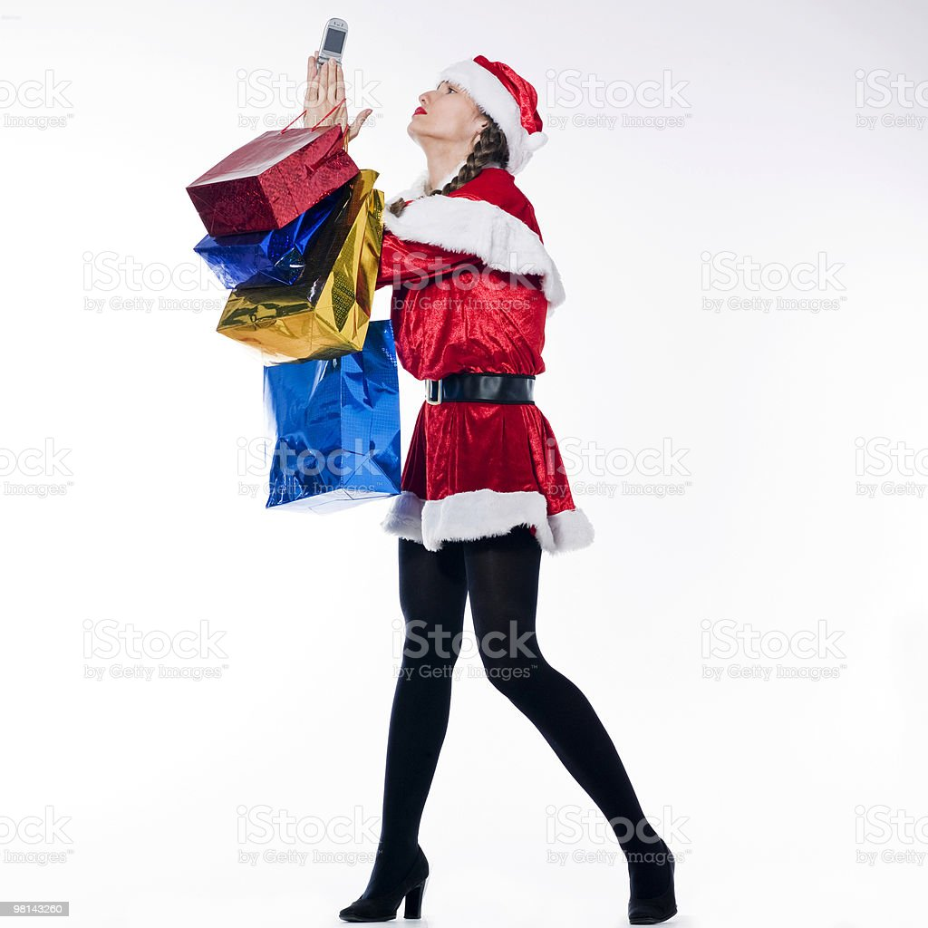 woman santa claus on the phone anxious Christmas Shopping bag royalty-free stock photo