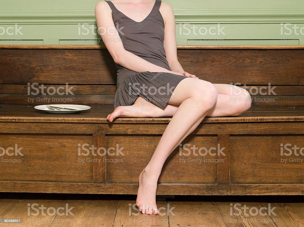 A woman sat on a bench 免版稅 stock photo