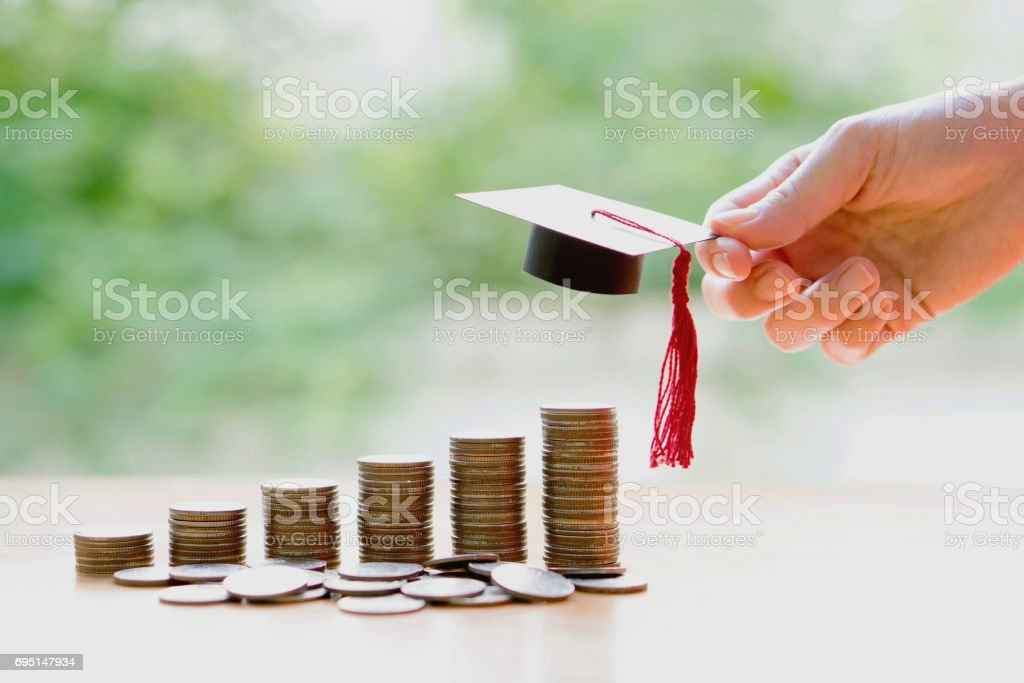 Woman saveing for eudcation stock photo