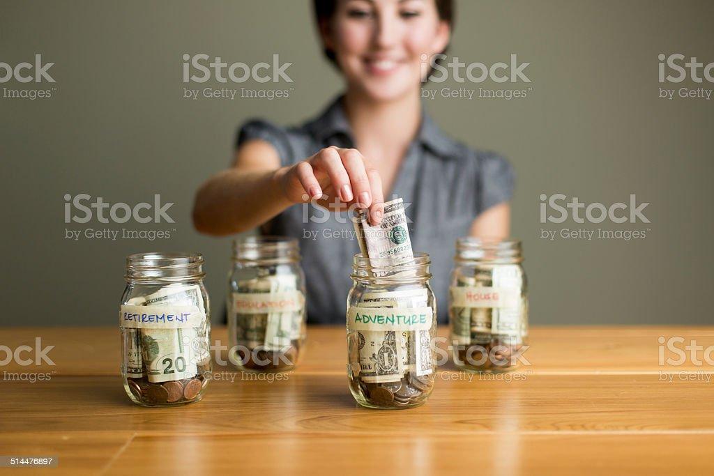Woman saving in jars royalty-free stock photo