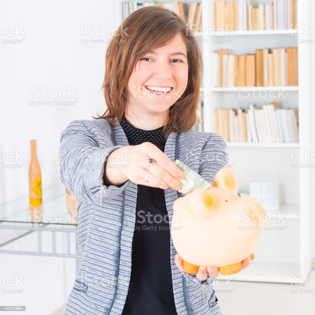 Woman saving money stock photo