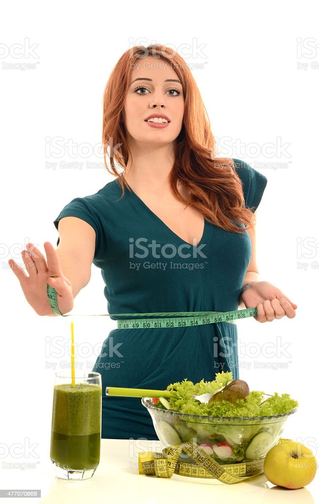Woman saying no to diet, holding a measuring tape. stock photo