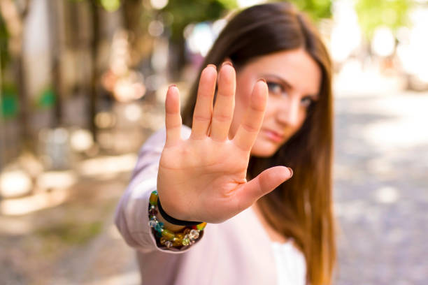 woman says stop Woman with her hand extended signaling to stop. Negative human emotion. Body language. Keep the distance self defense stock pictures, royalty-free photos & images