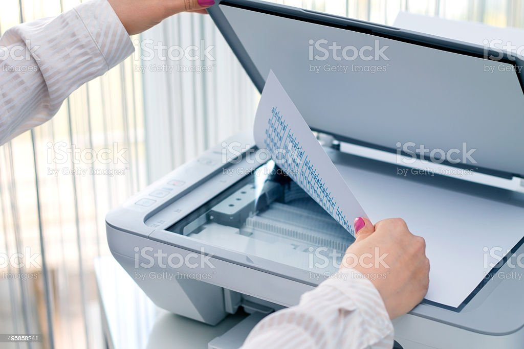 Woman scan some documents at work stock photo