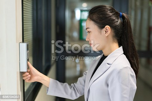 istock Woman scaning finger print for enter security system 638204032