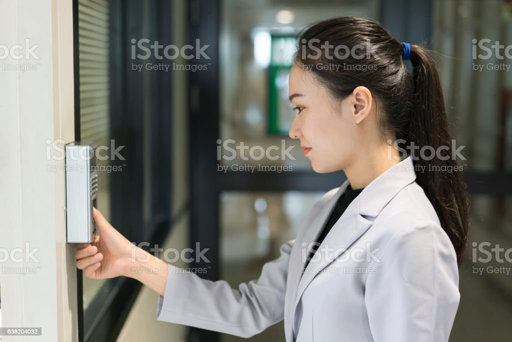 Woman scaning finger print for enter security system stock photo