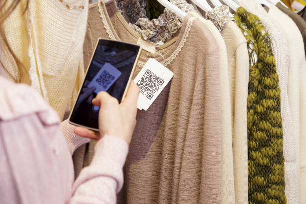 Woman scanning a QR code from a label. stock photo