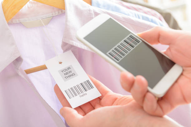Woman scanning barcode with mobile phone stock photo