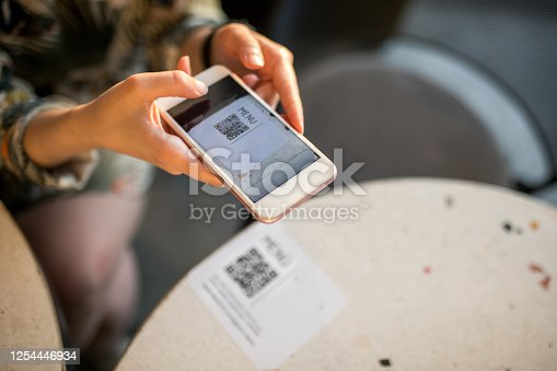 woman scanning qr code for online menu