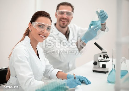 661098200istockphoto woman scientist and her assistant working in the laboratory 1027904122