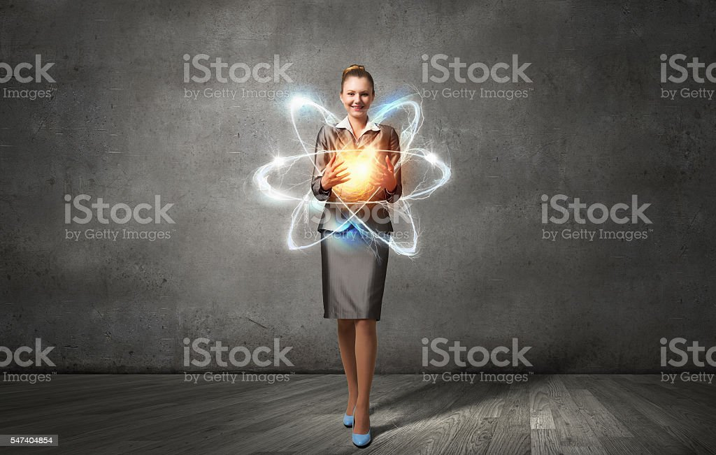 Woman scientist presenting atom research concept . Mixed media stock photo