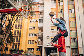 Man and woman, young couple on streetball court outdoors.