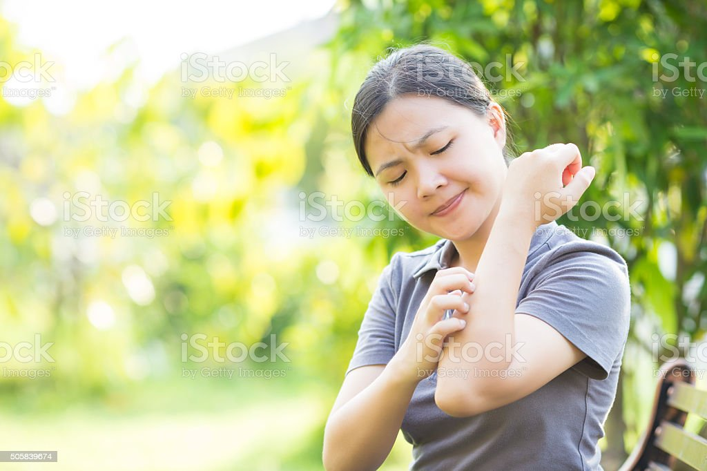 Woman Scraching her Self stock photo