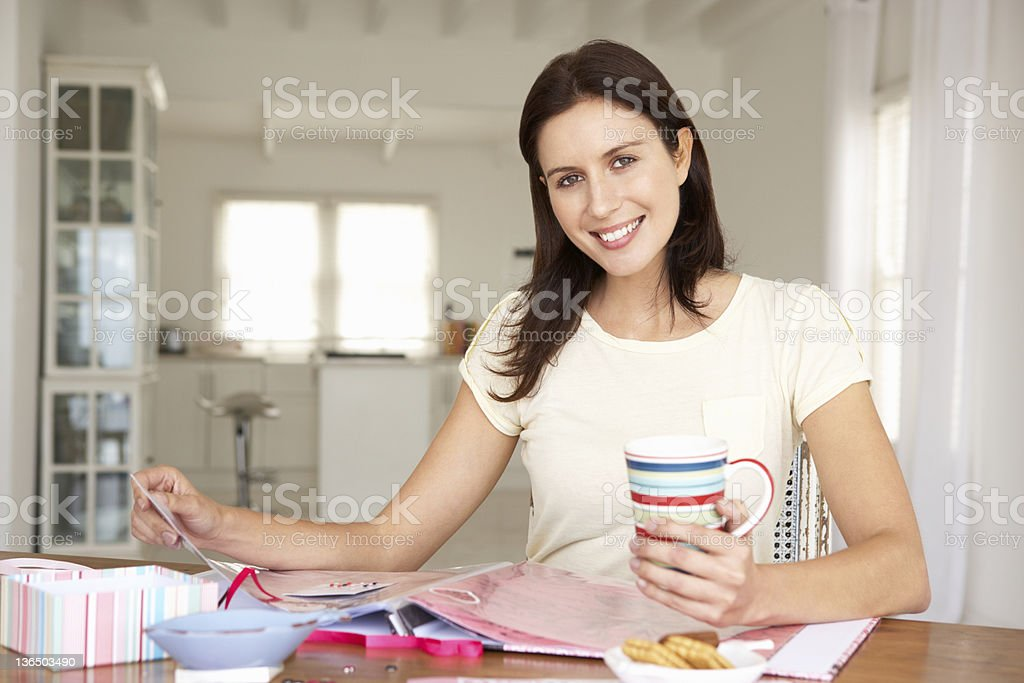 Woman scrapbooking stock photo