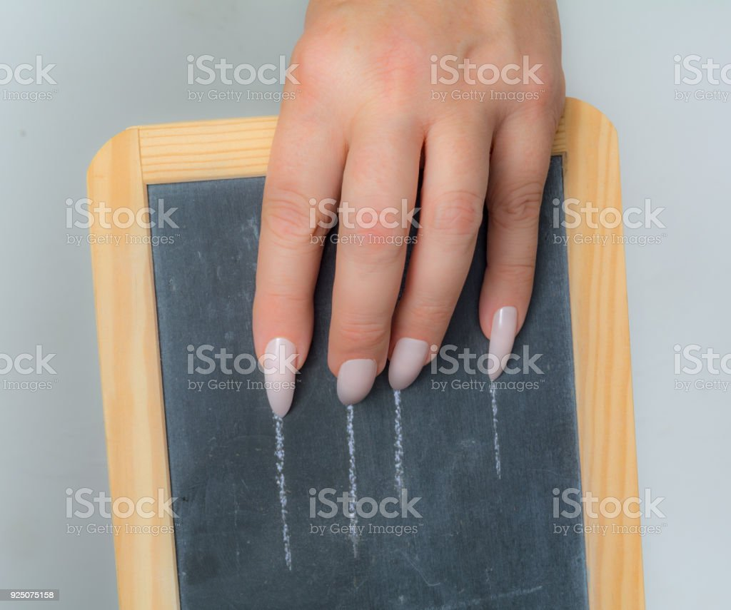Woman Scratches Her Slate With Her Long Nails Stock Photo & More ...