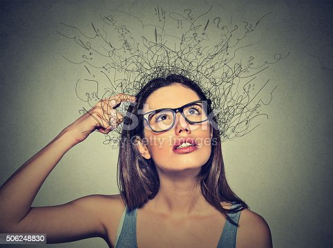 istock woman scratching head, thinking brain melting into lines 506248830
