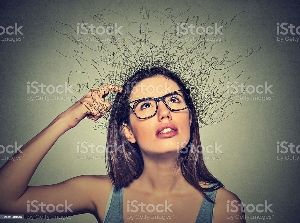 woman scratching head, thinking brain melting into lines stock photo