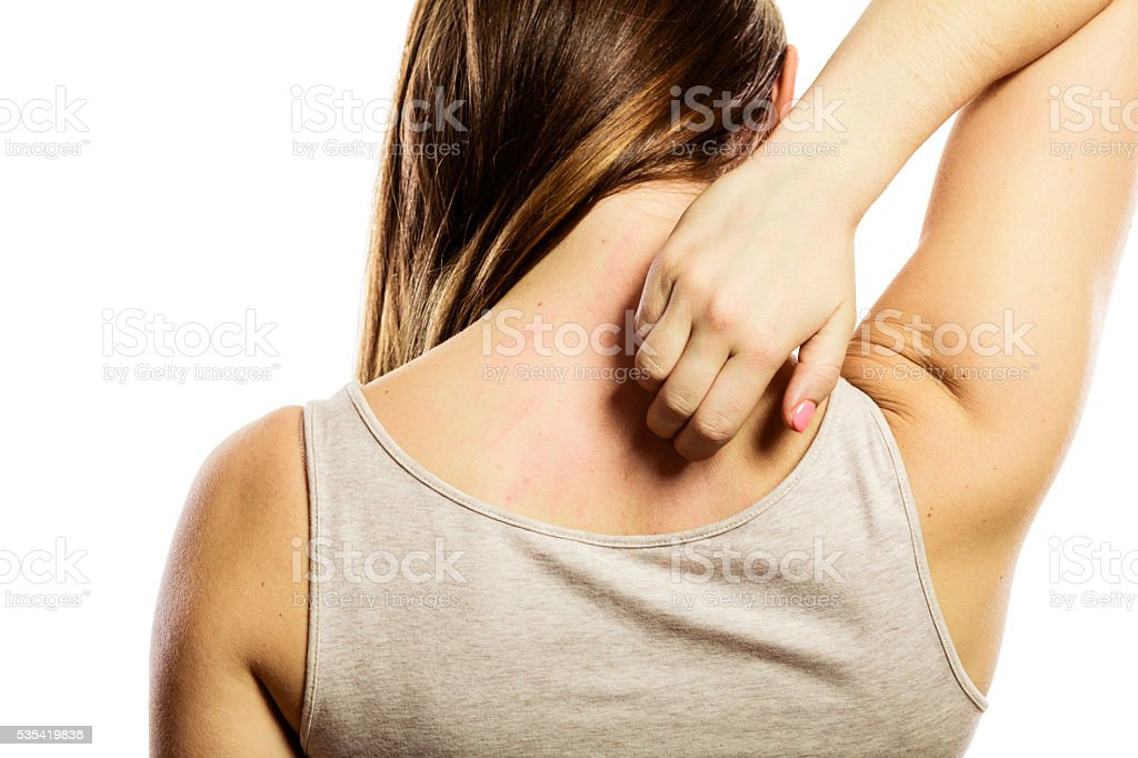 Woman scratching her back isolated stock photo