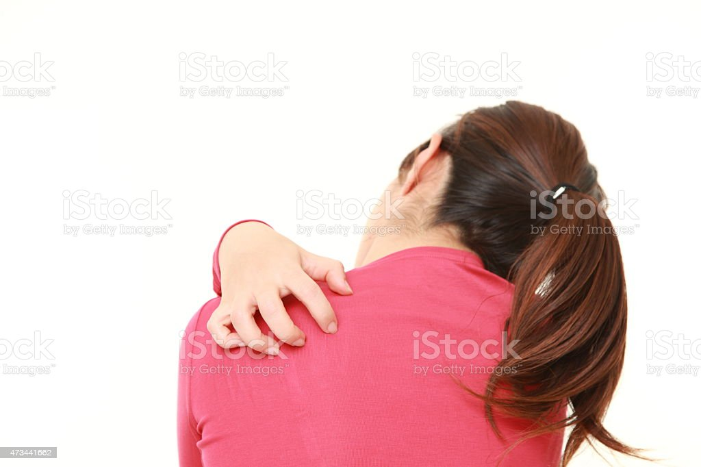 woman scratching her back stock photo