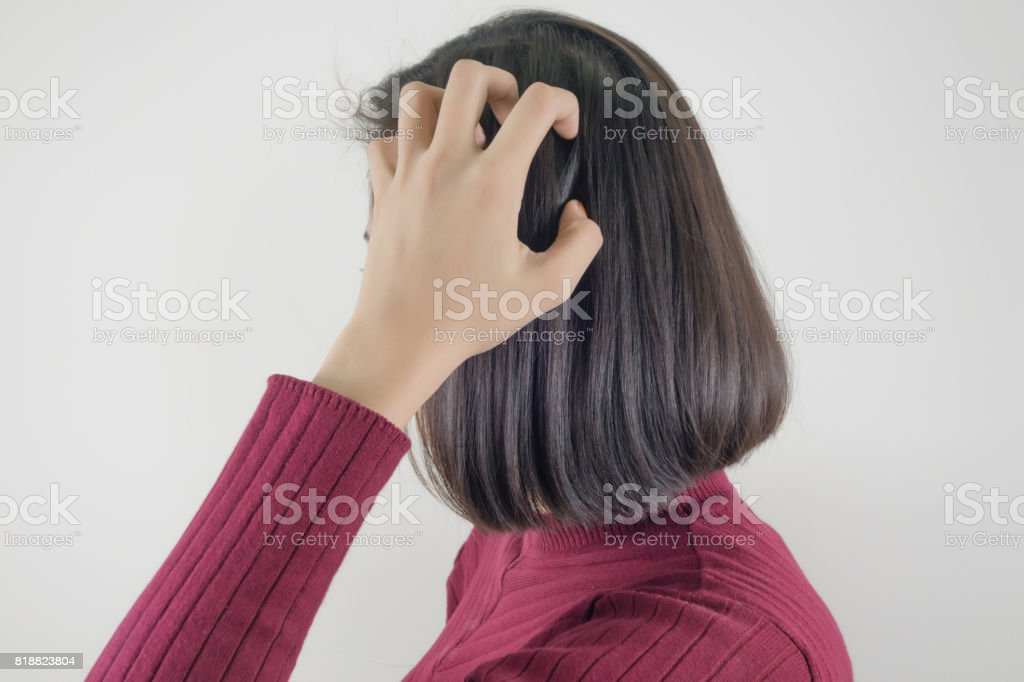 Woman scratching her head stock photo