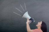 istock Woman Screaming in Megaphone on blackboard 517151368