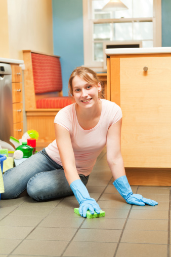 Woman Scrubbing Kitchen Floor In Spring Cleaning Home ...