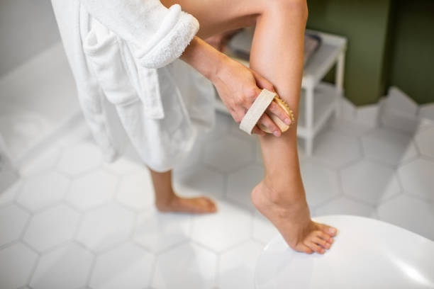 woman scrubbing legs - dry stock pictures, royalty-free photos & images