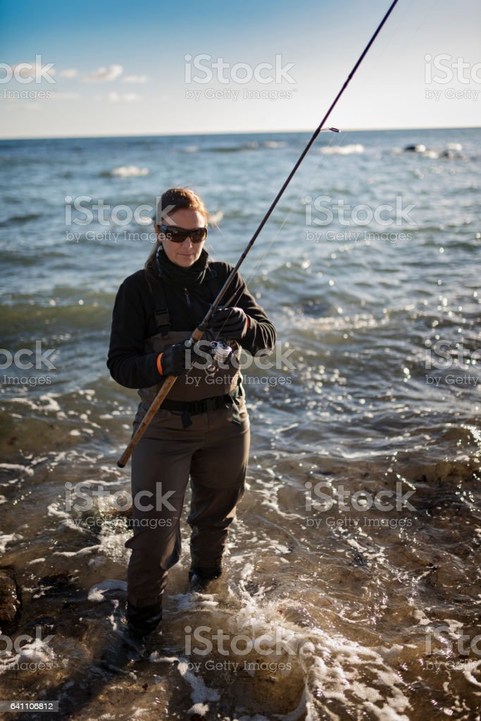 Woman Sea Fishing at Møns Klint Denmark stock photo