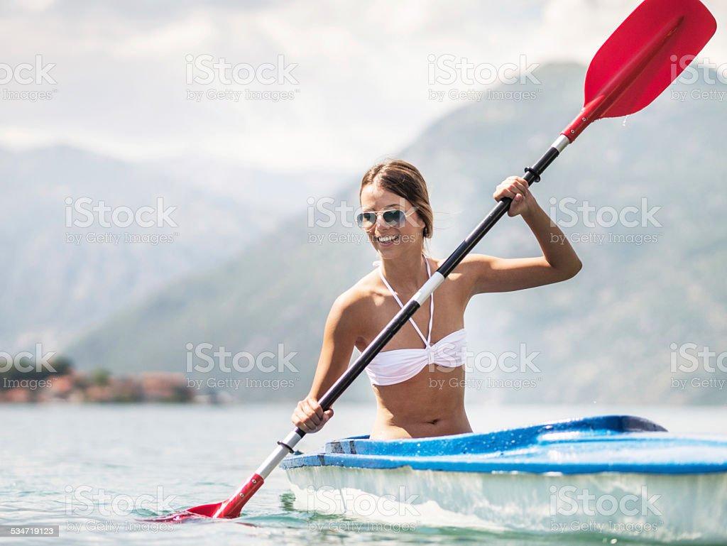Woman sea kayaking. stock photo