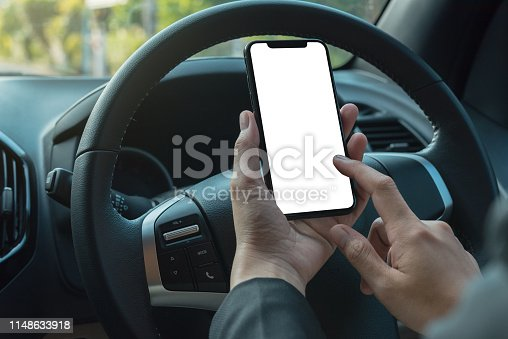istock woman searching destination direction or address on gps or navigator application via mobile smartphone inside a car while driving car, close up 1148633918