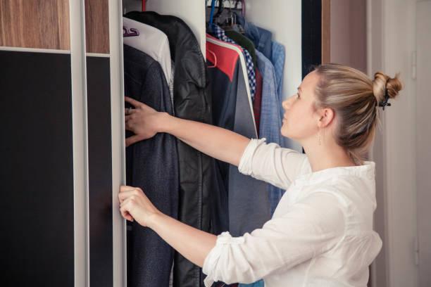 Woman searching the closet stock photo