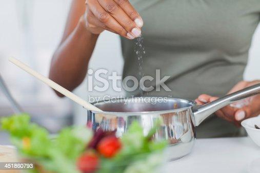 istock Woman seasoning her pot 451860793