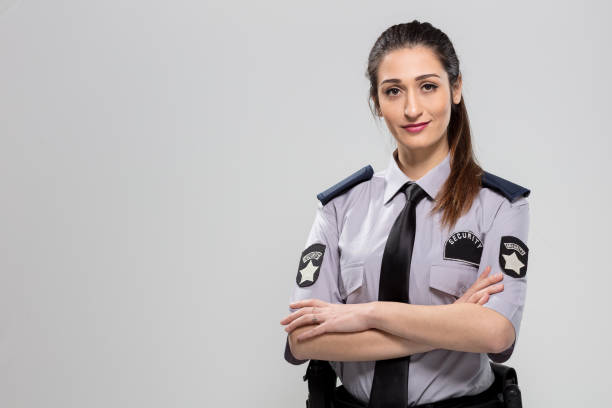 Woman Security Guard Woman Security Guard police uniform stock pictures, royalty-free photos & images