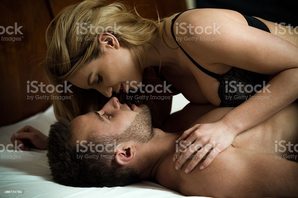 Woman seducing man stock photo