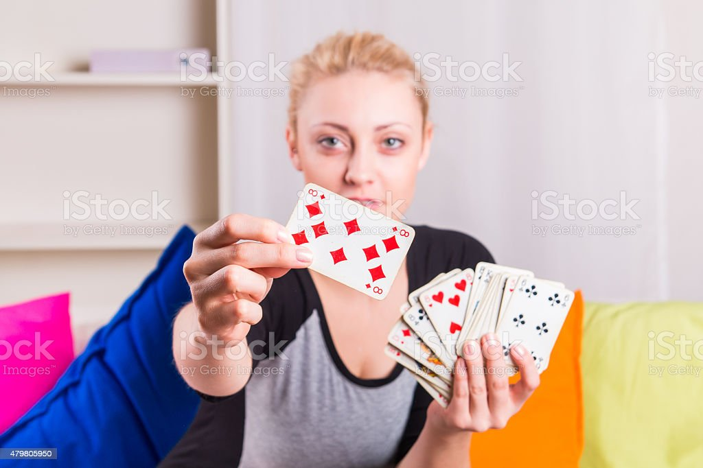 Woman select a card from the deck stock photo