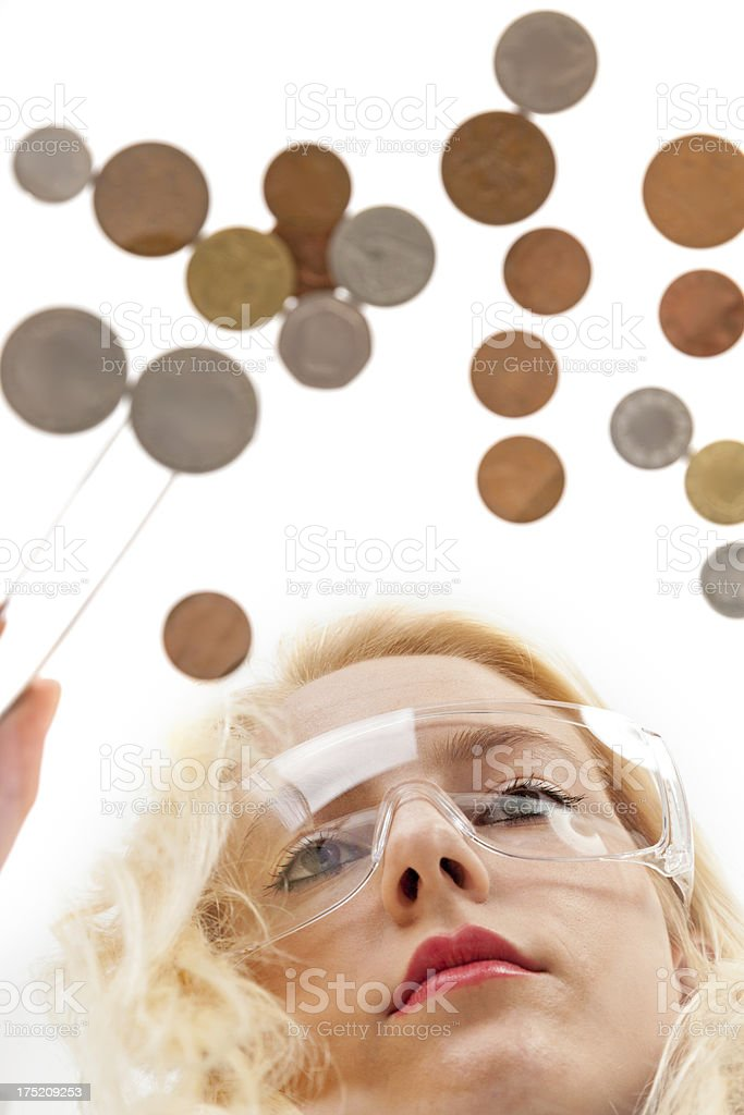 Woman selecting coins with tweezers royalty-free stock photo