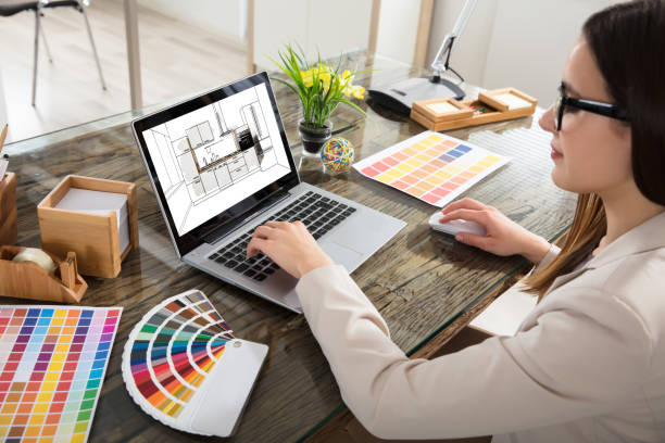 Woman Selecting Color For The Kitchen Room An Female Architect Working On Color Selection For The Kitchen Drawing On Laptop Screen design professional stock pictures, royalty-free photos & images