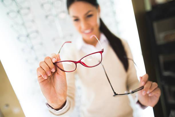 Woman selecting eyeglasses in optical store picture id625596630?b=1&k=6&m=625596630&s=612x612&w=0&h=abrdbecuorkcbfwysgsnlk9ozb9phofepprwu0c0o5q=