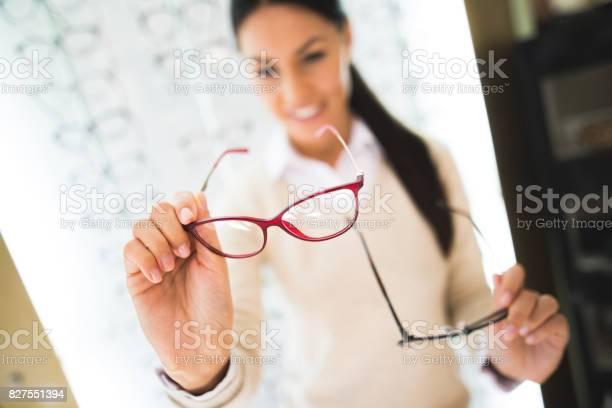 Woman selecting eyeglasses in optical store picture id827551394?b=1&k=6&m=827551394&s=612x612&h=njto8dysyvhvv3kmigmyr8na5b1wxv1tt9ux3bxdw0i=