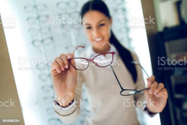 Woman selecting eyeglasses in optical store picture id944696264?b=1&k=6&m=944696264&s=612x612&h=bulrhokmkia rz9mw9r9hlyqxo8fya798c9 axljn9s=
