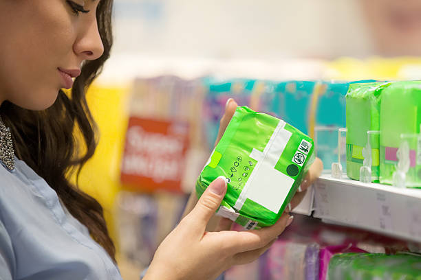woman selecting pad - sanitary pad stock photos and pictures