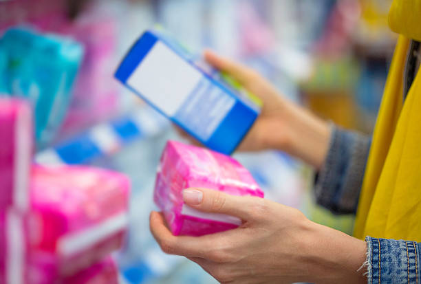 Woman selecting tampon Shopping for  tampon tampon stock pictures, royalty-free photos & images