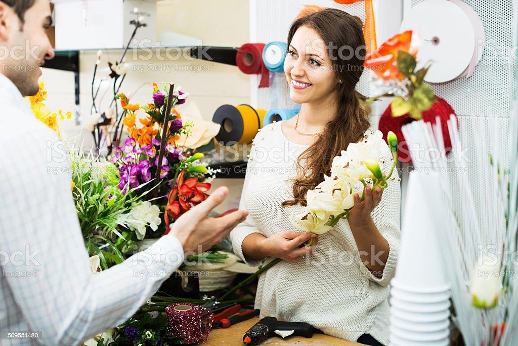Woman seller in flower shop stock photo