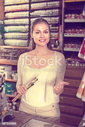 594918592 istock photo woman seller standing at counter 587545956