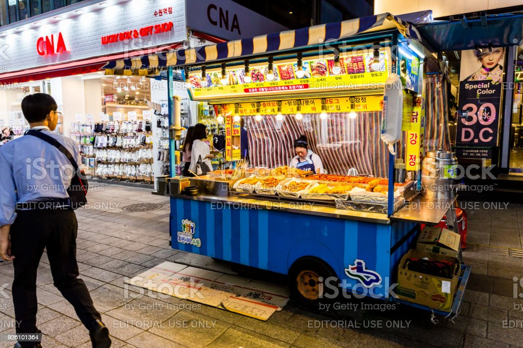 Woman Seller Waiting Of Buyers In Her Fast Food Kiosk At