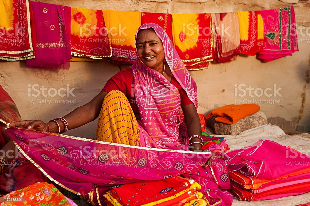 Woman selling colorful fabrics Colorful fabrics for sale,Rajasthan, India.http://bem.2be.pl/IS/rajasthan_380.jpg Adult Stock Photo
